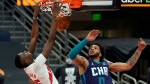 Toronto Raptors forward Chris Boucher (25) dunks over Charlotte Hornets forward Miles Bridges (0) during the second half of an NBA basketball game Thursday, Jan. 14, 2021, in Tampa, Fla. (AP Photo/Chris O'Meara)