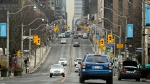 Traffic moves along Yonge Street during the COVID-19 pandemic in Toronto on Thursday, January 14, 2021. The province of Ontario is currently under an emergency order lockdown. THE CANADIAN PRESS/Nathan Denette
