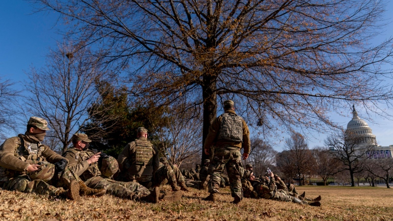 Members of the National Guard take a break while guarding the Capitol Building on Capitol Hill in Washington, Thursday, Jan. 14, 2021. (AP / Andrew Harnik)