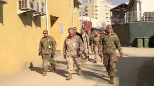 In this Jan. 31, 2020, file photo Marine Gen. Frank McKenzie, centre, top U.S. commander for the Middle East, makes an unannounced visit in Kabul, Afghanistan. (AP Photos/Lolita Baldor, File)