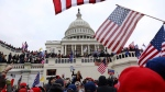 In this Wednesday, Jan. 6, 2021 file photo, supporters of President Donald Trump gather outside the U.S. Capitol in Washington. (AP Photo/Shafkat Anowar)