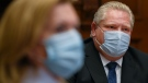 Ontario Premier Doug Ford, right, gives an update regarding the Ontario COVID-19 vaccine during the COVID-19 pandemic in Toronto on Tuesday, January 5, 2021. THE CANADIAN PRESS/Nathan Denette