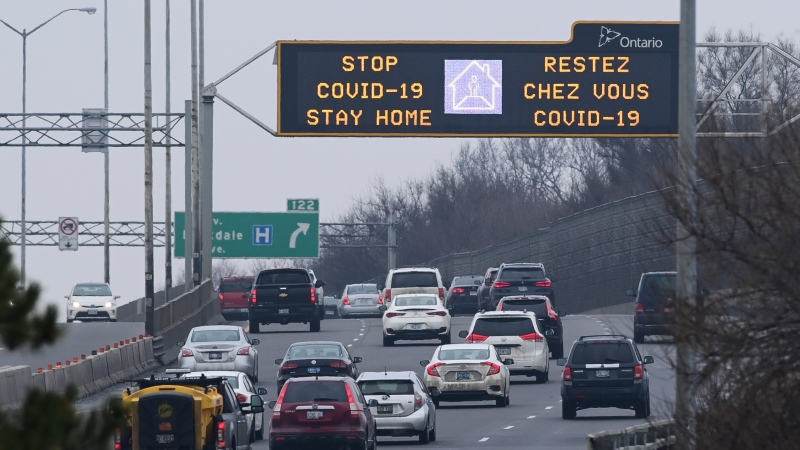 A highway sign notifies drivers to stay-home as they make their way along the Queensway in Ottawa on Thursday, Jan. 14, 2021. (Sean Kilpatrick/THE CANADIAN PRESS)