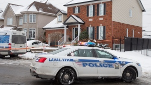 Police investigate the crime scene where a seven-year-old girl was found dead in her family's home, Monday, January 4, 2021 in Laval, Que. THE CANADIAN PRESS/Ryan Remiorz