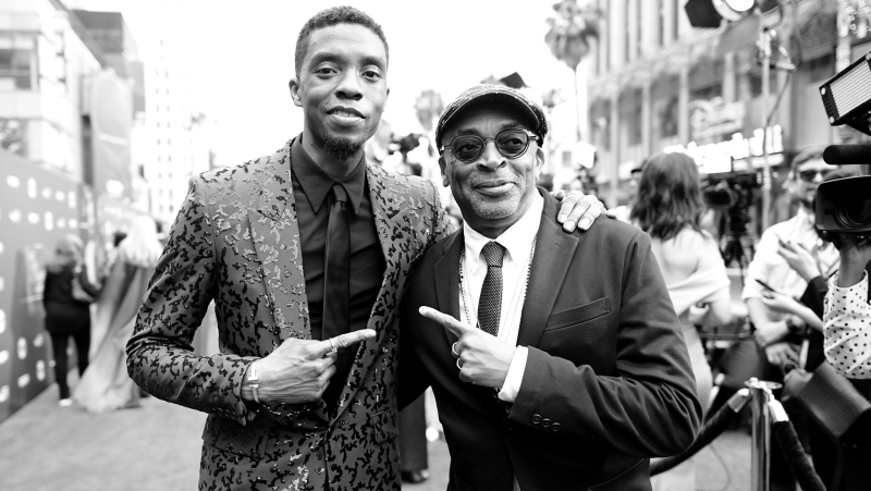 The late star Chadwick Boseman, left, with director Spike Lee. Lee remembers Boseman while accepting the American Cinematheque honor. (Charley Gallay/Getty Images for WarnerMedia via CNN)