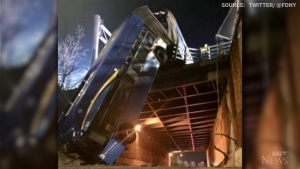 Eight people were injured, including the driver, after an articulated bus hit a guardrail and nearly fell off an overpass in New York City.