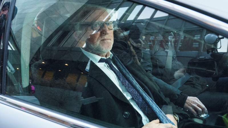 Just for Laughs founder Gilbert Rozon rides away in a car as he leaves the courthouse after being found not guilty in his sexual assault trial in Montreal on Tuesday, December 15, 2020. THE CANADIAN PRESS/Paul Chiasson