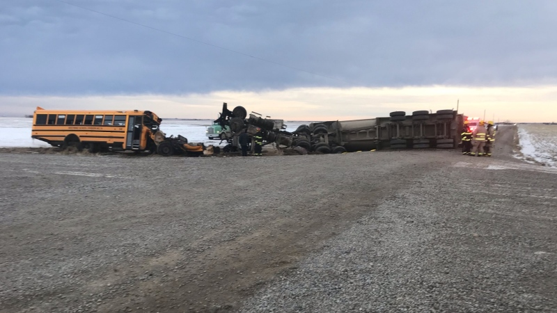 A bus and a semi carrying manure collided Friday morning north of Magrath, Alta. No students were on the bus at the time and both drivers were injured. (Photo contributed)