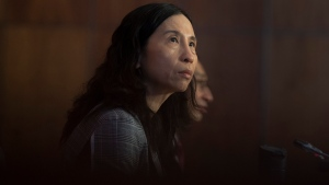 Chief Public Health Officer Theresa Tam looks at a giant screen showing data during a technical briefing on the COVID pandemic in Canada Friday January 15, 2021 in Ottawa. THE CANADIAN PRESS/Adrian Wyld