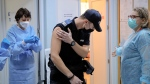 A Romanian gendarme leaves after receiving the Pfizer-BioNTech COVID-19 vaccine at a hospital in Bucharest, Romania, Friday, Jan. 15, 2021. (AP Photo/Vadim Ghirda)