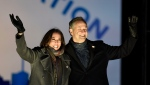 U.S. Vice-President elect Kamala Harris and her husband Doug Emhoff take the stage during a drive-in get out the vote rally, Monday, Nov. 2, 2020, in Philadelphia. (AP Photo/Michael Perez)