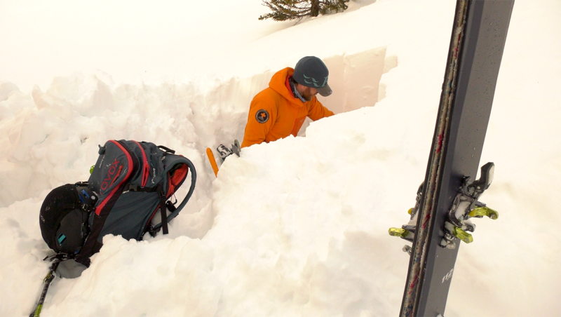 Public safety specialist Mike Koppang inside a snow pit looking for weak layers in the snow pack