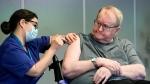 Nurse Maria Golding vaccinates Svein Andersen, in Oslo, Norway, Sunday, Dec. 27, 2020. (Fredrik Hagen/NTB via AP)