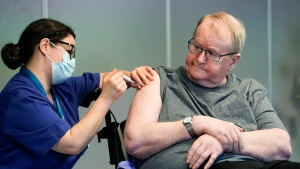Nurse Maria Golding vaccinates Svein Andersen, in Oslo, Norway, Sunday, Dec. 27, 2020. (Fredrik Hagen/NTB via AP)