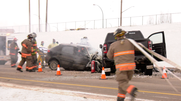 A firefighter on scene at a head-on crash on Circle Drive. (Chad Hills/CTV News)