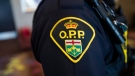 An Ontario Provincial Police crest is displayed on the arm of an officer during a press conference in Vaughan, Ont., on Thursday, June 20, 2019. THE CANADIAN PRESS/Andrew Lahodynskyj