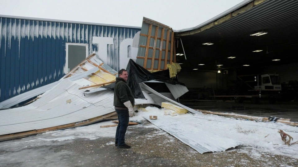 Alex Getzlaf surveys the damage at his shop in the RM of Bratt's Lake after a winter storm brought high winds. (Marc Smith / CTV NEWS)