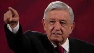 Mexico's President Andres Manuel Lopez Obrador gives his daily, morning news conference at the presidential palace, Palacio Nacional, in Mexico City, Monday, July 13, 2020. (AP Photo/Marco Ugarte)