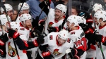 Ottawa Senators center Chris Tierney, top center, celebrates with teammates after his overtime goal against the San Jose Sharks in an NHL hockey game in San Jose, Calif., Saturday, March 7, 2020. (AP / Josie Lepe)