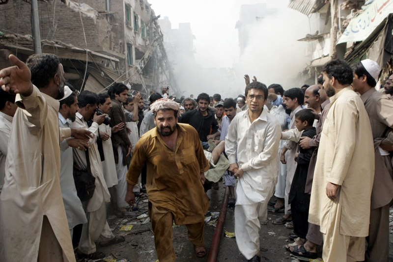 Rescue workers rush an injured person to a hospital after a car bomb explosion in Peshawar, Pakistan on Wednesday, Oct. 28, 2009. (AP / Mohammad Sajjad)
