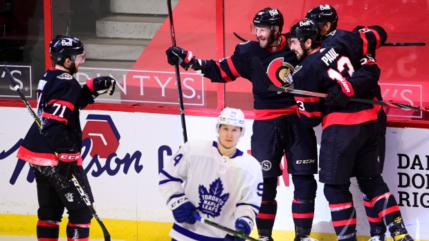 Ottawa Senators left wing Austin Watson (16), middle back, celebrates a goal with teammates as Toronto Maple Leafs left wing Alexander Barabanov (94) skates away during second period NHL action in Ottawa, Friday, Jan. 15, 2021. THE CANADIAN PRESS/Sean Kilpatrick