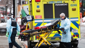 Paramedics arrive to pick up a patient at Verdun hospital Tuesday, January 12, 2021 in Montreal. Quebec Premier Francois Legault described the situation in Quebec hospitals as 'critical' especially in the Montreal region. THE CANADIAN PRESS/Ryan Remiorz