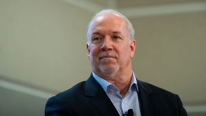 NDP Leader John Horgan listens during a physically distanced roundtable discussion with supporters and local candidates, in Pitt Meadows, B.C., on Friday, Oct. 16, 2020. A provincial election will be held in British Columbia on October 24. THE CANADIAN PRESS/Darryl Dyck