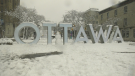 A snowman at the Ottawa sign on York Street in the ByWard Market after a significant snowfall Saturday, Jan. 16, 2021. (Shaun Vardon / CTV News Ottawa)