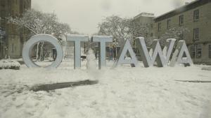 A snowman at the Ottawa sign on York Street in the ByWard Market after a significant snowfall Saturday, Jan. 16, 2021. (Shaun Vardon / CTV News Ottawa)