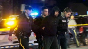 Around 3 a.m. on Saturday Jan. 16 in Coquitlam, B.C., a man was seen arrested by police after reports of a shooting in a high rise. Police have not said whether the man arrested was involved.