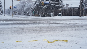 Police tape lies across the ground in the area of Hunt Club Road and Lorry Greenberg Drive, Saturday, Jan. 16, 2021. Ottawa police are investigating the shooting death of a man in this area. It's the first reported homicide of the year in Ottawa. (Mike Mersereau / CTV News Ottawa)