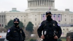 Capitol Police guard the U.S. Capitol in Washington, Friday, Jan. 15, 2021, ahead of the inauguration of President-elect Joe Biden and Vice President-elect Kamala Harris. (AP Photo/Susan Walsh)