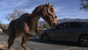 A new drive-thru exhibit in California let people see lifelike dinosaurs from the comfort of their car.