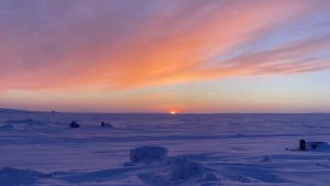 The sun rises for the first time in six weeks over Cambridge Bay, Nunavut on Wednesday, Jan. 13, 2021. (THE CANADIAN PRESS/HO-Pitquhirnikkut Ilihautiniq/Kitikmeot Heritage Society)