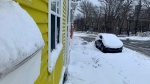 Snow covers a sidewalks and cars in St. John's on Saturday Jan. 16, 2021. The Newfoundland and Labrador election campaign kicked off today in St. John's under a blanket of snow while houses clattered in the strong winter winds. THE CANADIAN PRESS/Sarah Smellie