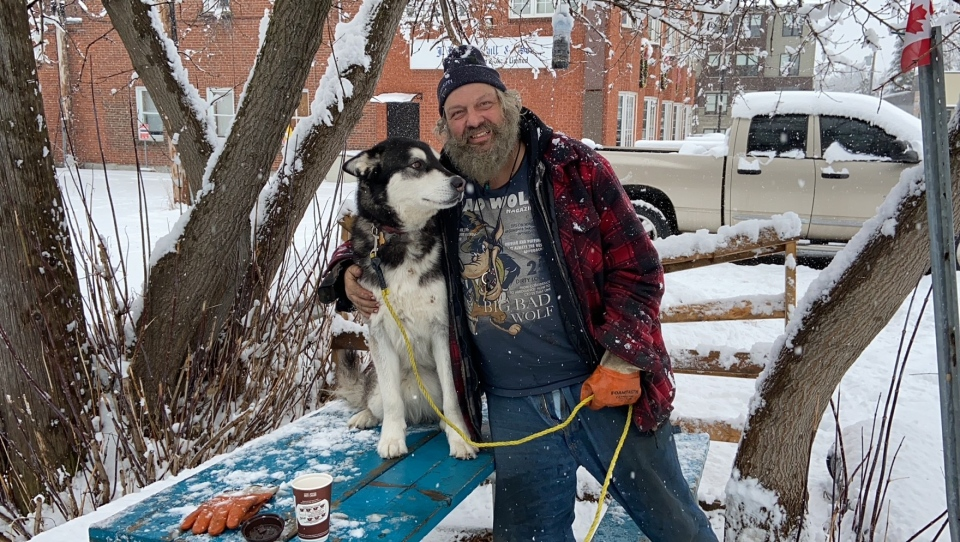 Guy Lamarche and his dog Gunner. (Dylan Dyson / CTV News Ottawa)