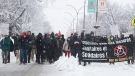 People participate in a demonstration opposing restrictions imposed by the Quebec government to help stop the spread of COVID-19 in Montreal, Saturday, January 16, 2021, as the pandemic continues in Canada and around the world. The Quebec government has imposed a lockdown and a curfew to help curb the spread of COVID-19. The curfew begins at 8 p.m until 5 a.m and lasting until February 8. THE CANADIAN PRESS/Graham Hughes