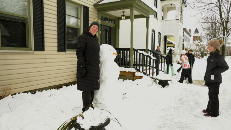 Building a snowman, complete with a carrot nose, was a popular activity in Ottawa following a blast of snow Jan. 16, 2021. (Shaun Vardon / CTV News Ottawa)