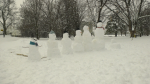 A snow family in Stanley Park next to the Rideau River in Ottawa. Jan. 26, 2021. (Shaun Vardon / CTV News Ottawa)