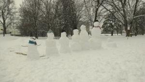 A snow family in Stanley Park next to the Rideau River in Ottawa. Jan. 16, 2021. (Shaun Vardon / CTV News Ottawa)