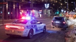 A car is pulled over by a police cruiser in Montreal, Saturday, January 9, 2021, as the COVID-19 pandemic continues in Canada and around the world. The Quebec government has imposed a curfew to help stop the spread of COVID-19 starting at 8 p.m until 5 a.m and lasting until February 8.THE CANADIAN PRESS/Graham Hughes