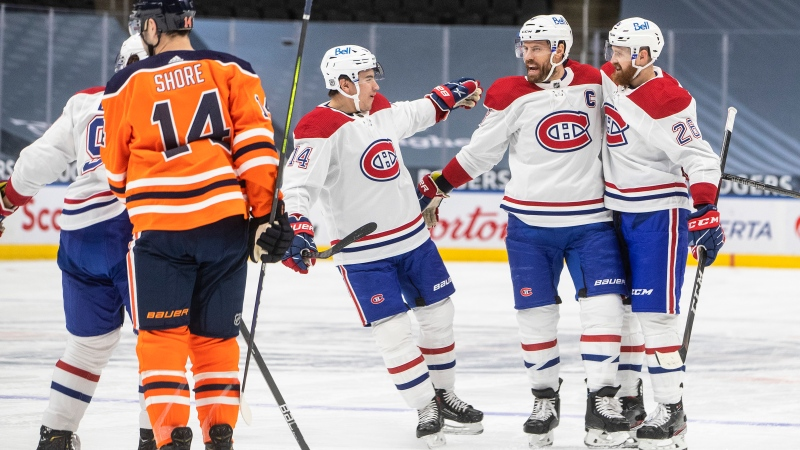 Edmonton Oilers' Devin Shore (14) skates past as Montreal Canadiens' Nick Suzuki (14), Shea Weber (6) and Jeff Petry (26) celebrate a goal during first period NHL action in Edmonton on Saturday, January 16, 2021. THE CANADIAN PRESS/Jason Franson