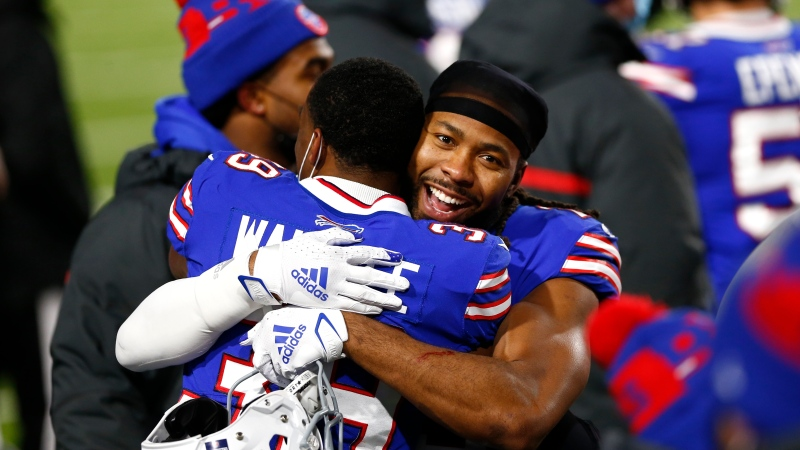 Buffalo Bills cornerback Josh Norman, right, hugs Levi Wallace (39) after an NFL divisional round football game against the Baltimore Ravens Saturday, Jan. 16, 2021, in Orchard Park, N.Y. The Bills won 17-3. (AP Photo/John Munson)