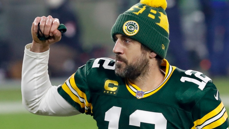 Green Bay Packers quarterback Aaron Rodgers pumps his first after an NFL divisional playoff football game against the Los Angeles Rams Saturday, Jan. 16, 2021, in Green Bay, Wis. The Packers defeated the Rams 32-18 to advance to the NFC championship game. (AP Photo/Mike Roemer)