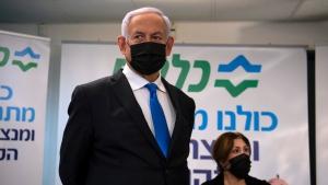 Israeli Prime Minister Benjamin Netanyahu visits a coronavirus vaccination facility in the northern Arab city of Nazareth, Israel, Wednesday, Jan. 13, 2021. (Gil Eliyahu/Pool via AP)