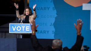 U.S. Vice President-elect Kamala Harris speaks at a drive-in rally during a campaign stop for Democratic U.S. Senate candidates the Rev. Raphael Warnock and Jon Ossoff, Sunday, Jan. 3, 2021, in Savannah, Ga. (AP Photo/Stephen B. Morton)