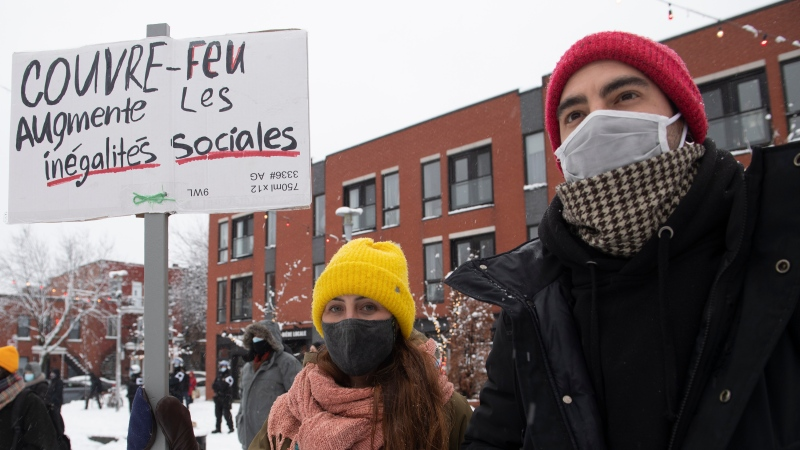 People participate in a demonstration opposing a curfew imposed by the Quebec government to help stop the spread of COVID-19 in Montreal, Saturday, January 16, 2021, as the pandemic continues in Canada and around the world. The curfew begins at 8 p.m until 5 a.m and lasting until February 8. THE CANADIAN PRESS/Graham Hughes