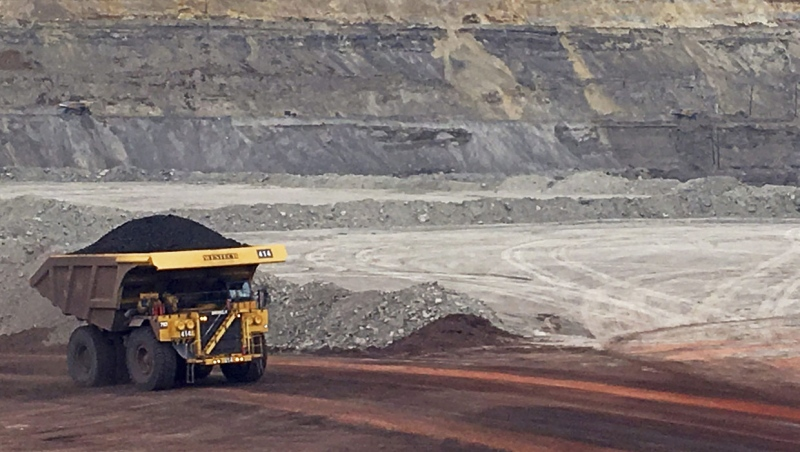 In this March 28, 2017, file photo, a dump truck hauls coal at Contura Energy's Eagle Butte Mine near Gillette, Wyo. The Alberta government is changing coal policies to make it easier to develop open-pit mines in one of the province's most sensitive areas. THE CANADIAN PRESS/AP/Mead Gruver, File