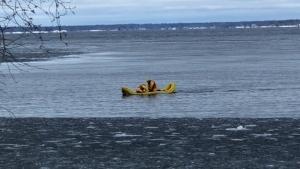 Snowmobiler crashes through ice