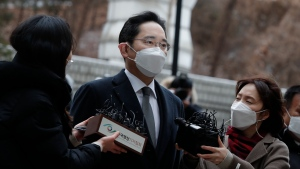 Samsung Electronics Vice Chairman Lee Jae-yong is questioned by reporters upon his arrival at the Seoul High Court in Seoul, South Korea, Monday, Jan. 18, 2021. (AP Photo/Lee Jin-man)